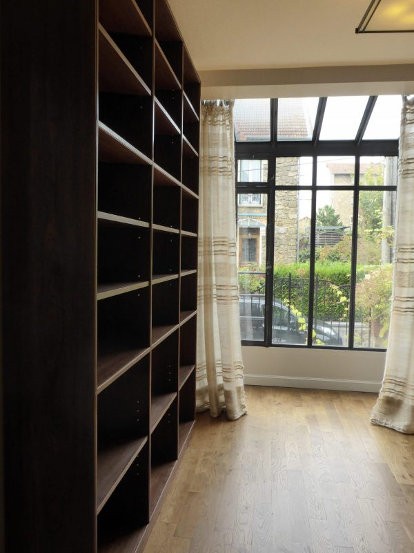 Bespoke-book-shelving-in-walnut-and-sycamore