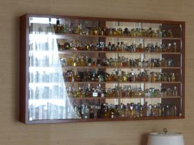 showcase for perfume miniatures atelier de