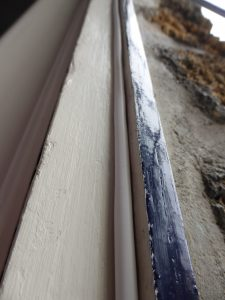 insulating-joint-inserted-into-groove-around-door-frame