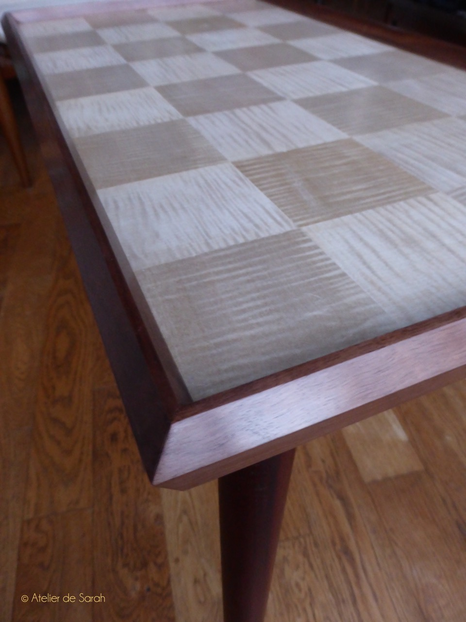 Coffee-table-with-checker-motif-in-sycamore-and-frame-edge-in-solid-walnut
